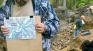 Археолог Игорь Кондратьев с картой раскопок